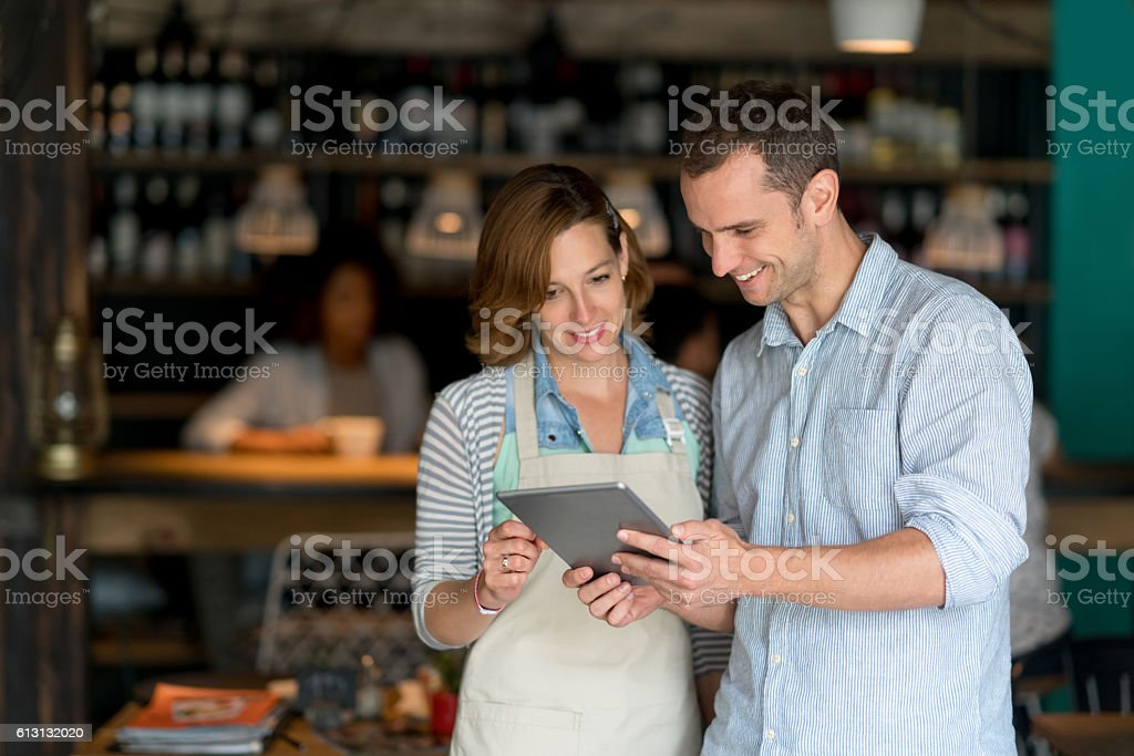 Woman talking to manager at a restaurant stock photo