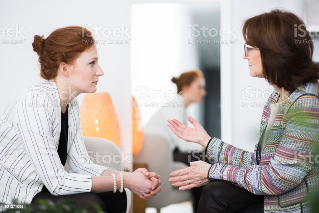 Woman talking to patient stock photo