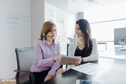 istock Woman talking together in design studio office 637928838