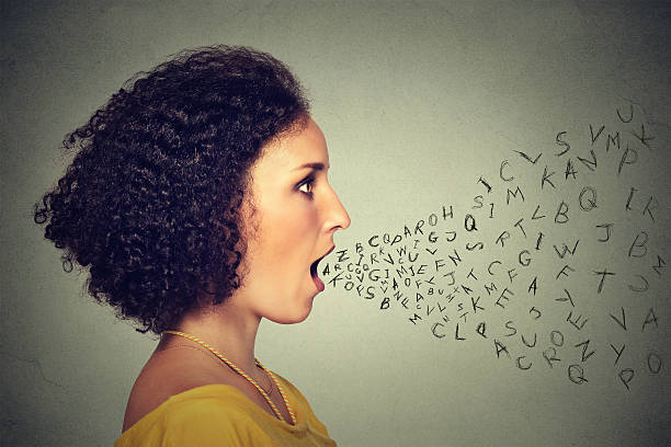 Woman talking with alphabet letters coming out of mouth Woman talking with alphabet letters coming out of her mouth. Communication, information, intelligence concept single word stock pictures, royalty-free photos & images