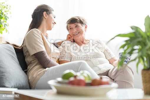 istock Woman talking with elderly mother 874860782