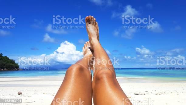 Woman tanned skin legs on the beach picture id1163483221?b=1&k=6&m=1163483221&s=612x612&h=lbb y8 z47opwj azffeosrd ut5qhl68xogfksxq9o=