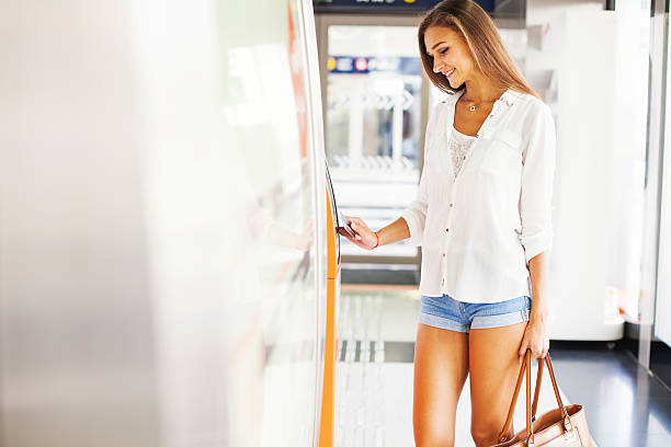 Woman tapping an access card – Foto