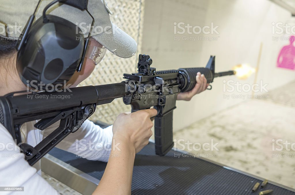 253cccfbe3793 Woman Target Shooting With Assault Rifle Stock Photo & More Pictures ...