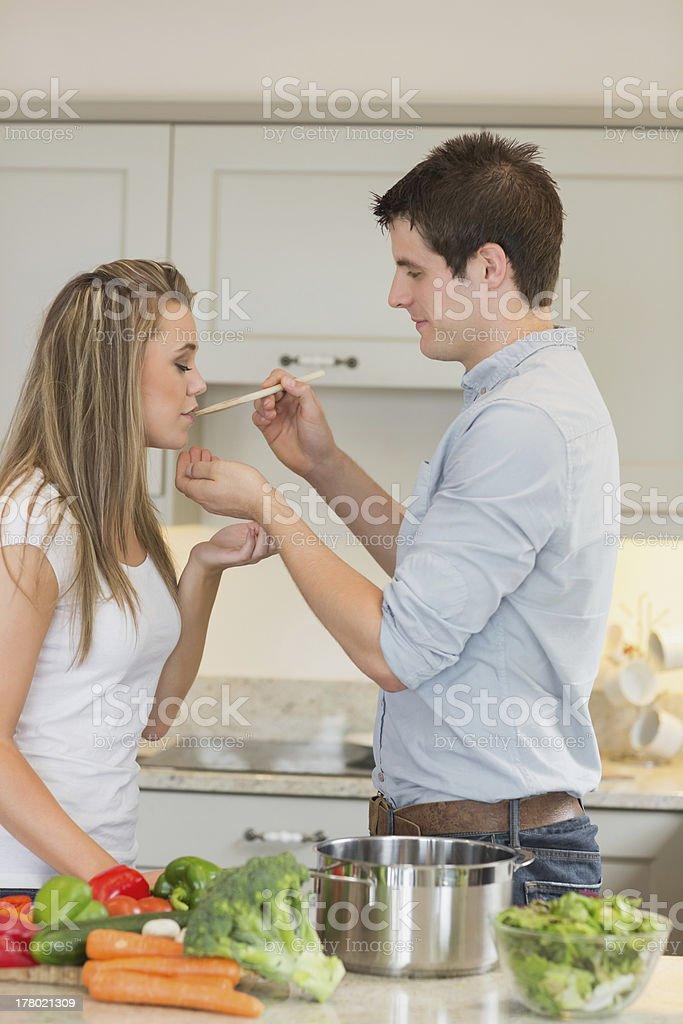 Woman tastes meal royalty-free stock photo
