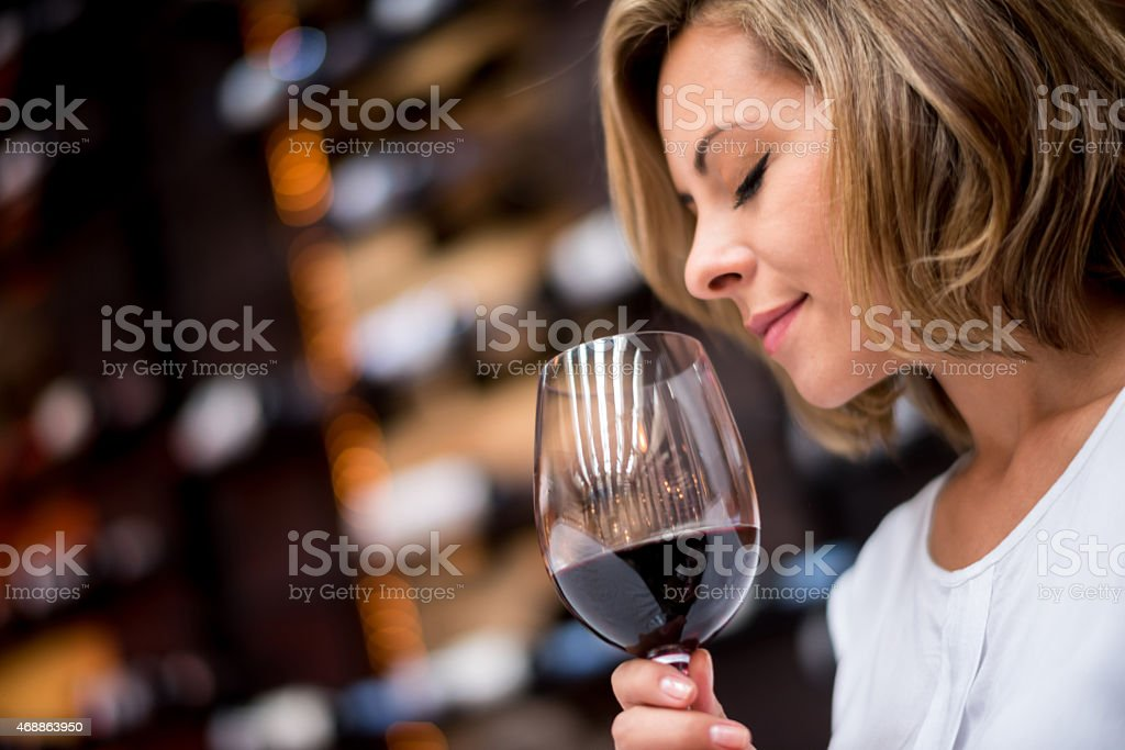 Woman tasting wine at a cellar stock photo