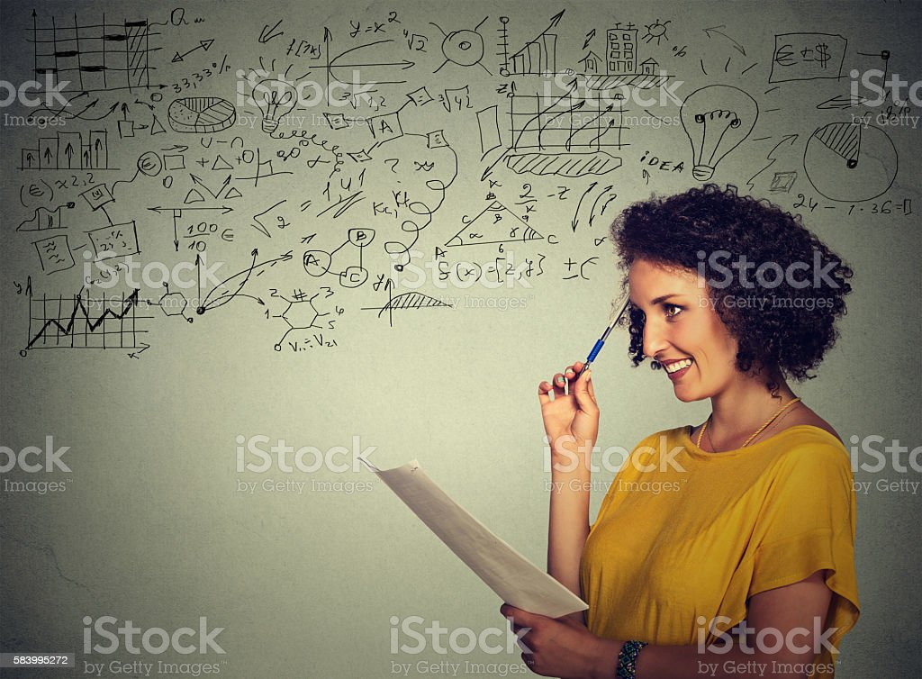 woman teacher standing by chalkboard with math science formulas stock photo