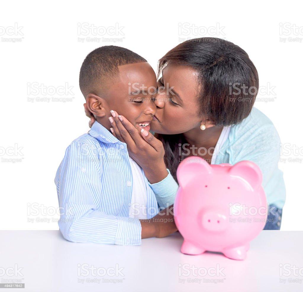 Woman teaching son to save money stock photo