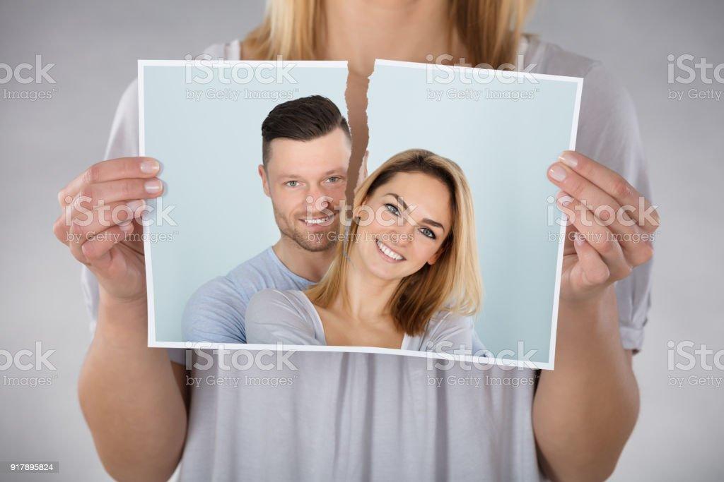 Woman Tearing Photo stock photo