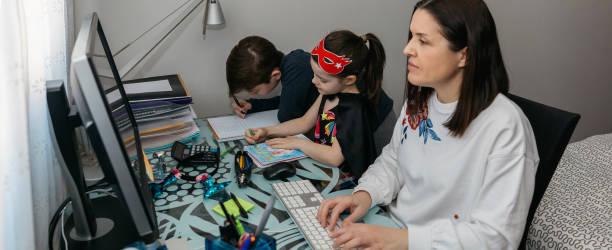 Woman teleworking with her children doing homework picture id1217979979?b=1&k=6&m=1217979979&s=612x612&w=0&h=bjegvdtcezdcbzacofjo5a4pcboogjmef rcips4iz4=