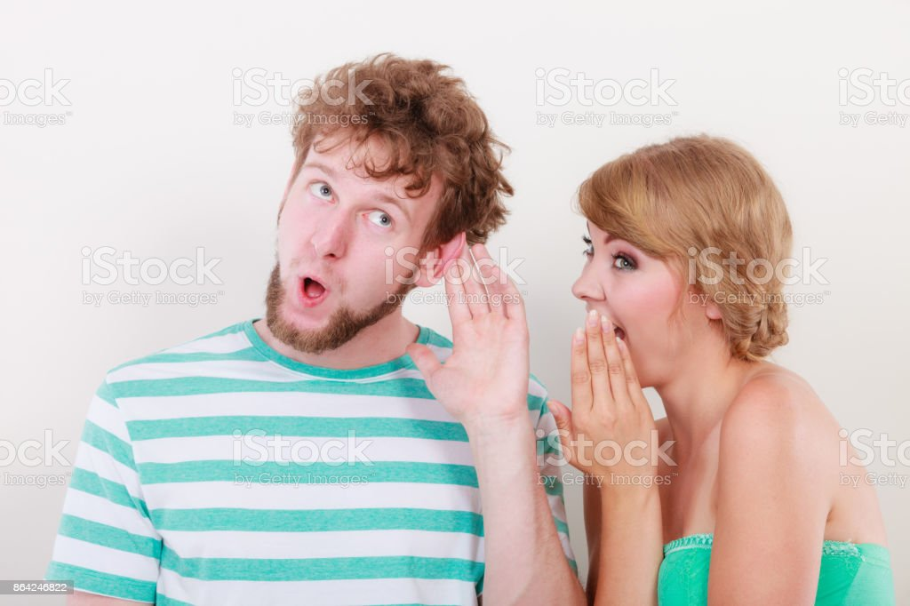 Woman telling an astonished man some secrets royalty-free stock photo