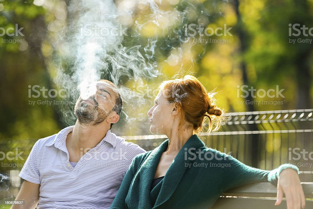 Woman telling her boyfriend to finally stop smoking stock photo