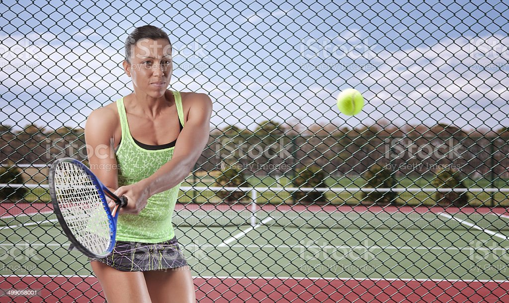 Woman Tennis Player in Action stock photo