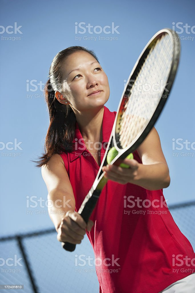 woman tennis player serving royalty-free stock photo