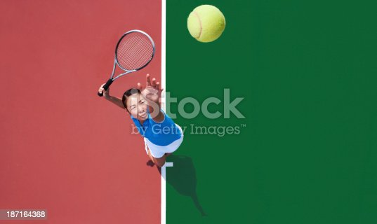 istock woman tennis player serving 187164368