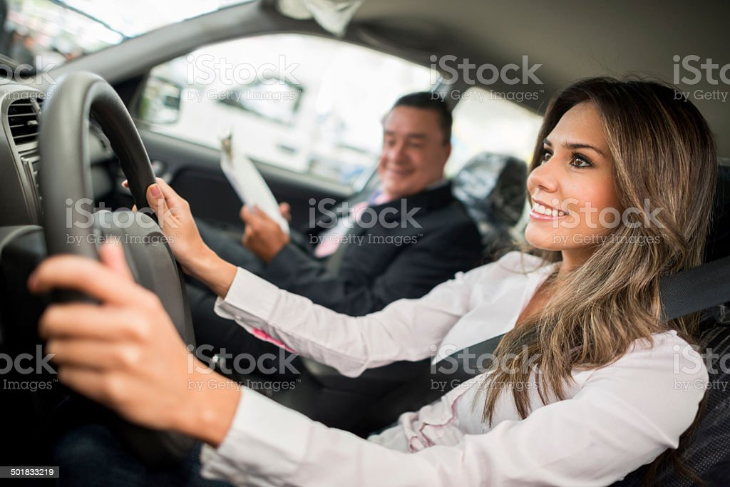 Woman test driving a car stock photo