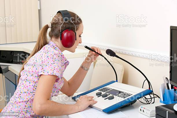 Woman Testing Hearing Stock Photo - Download Image Now