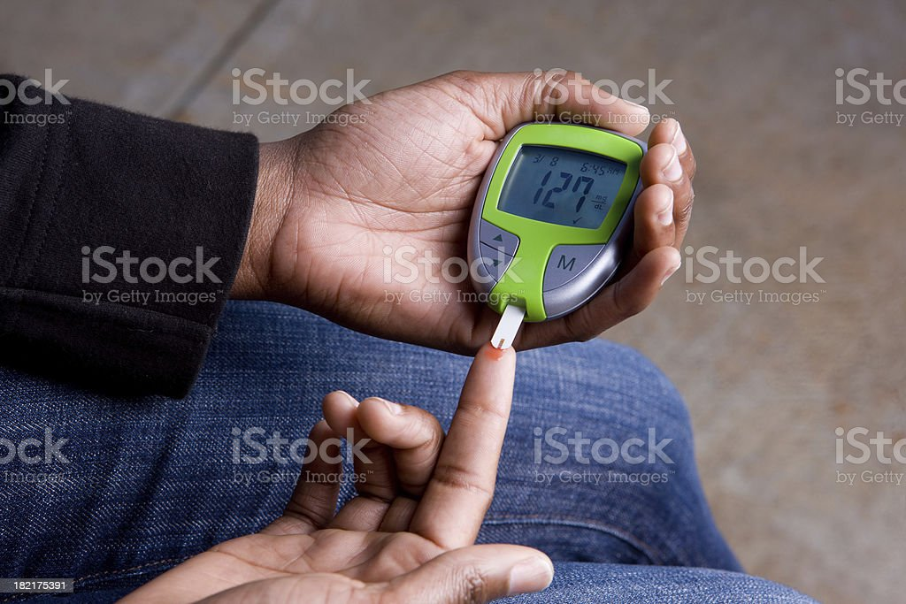 Woman Tests Blood Sugar Which Is High stock photo