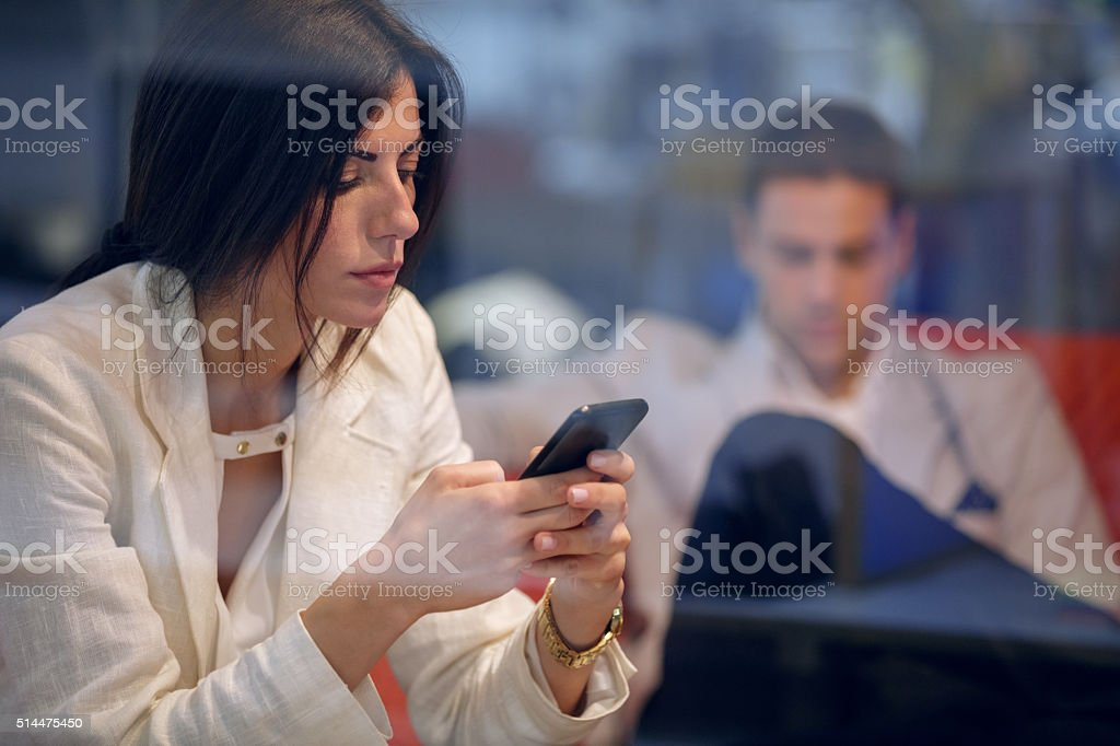 Woman text messaging stock photo