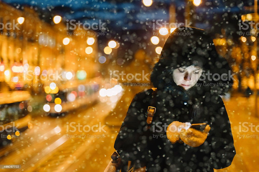 Woman texting at the street stock photo
