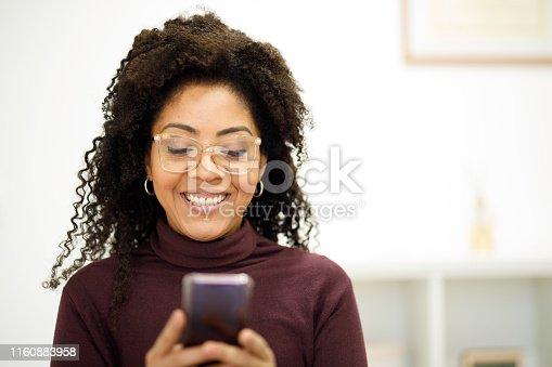 1150572074istockphoto Woman texting on phone 1160883958