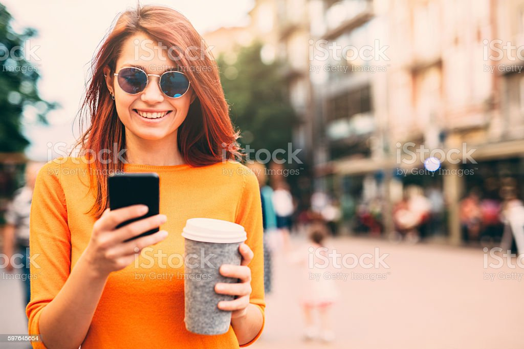 Woman texting outdoor stock photo