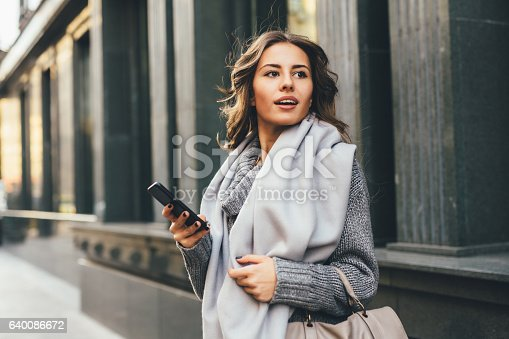 istock Woman texting outdoors 640086672