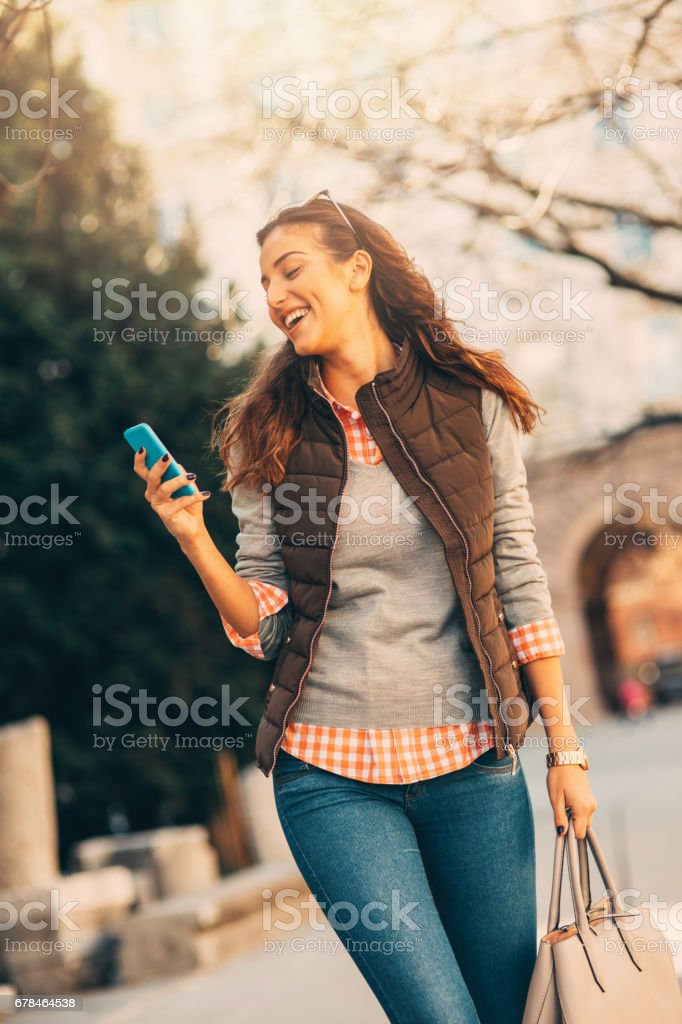 Woman texting outdoors. royalty-free stock photo