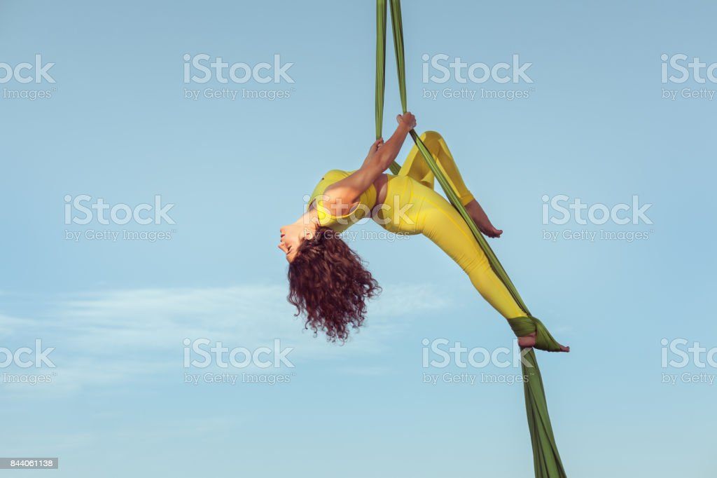 Woman the equilibrist does a performance. stock photo