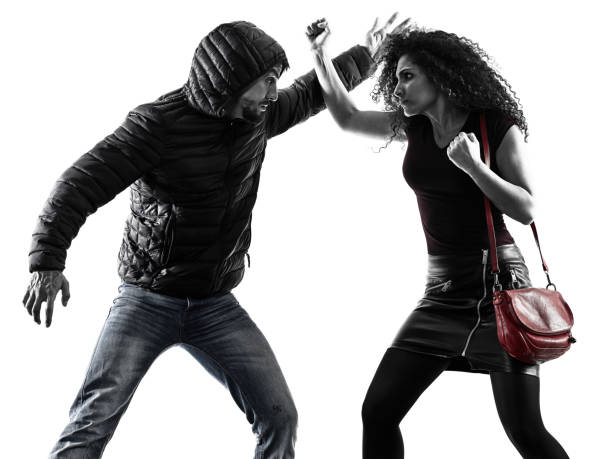 woman thief aggression self defense isolated one caucasian woman victim of a thief aggression self defense isolated on white background self defense stock pictures, royalty-free photos & images