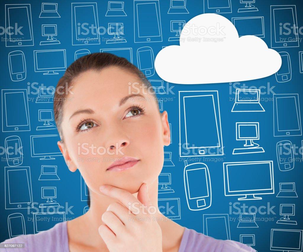 Woman thinking about cloud computing stock photo