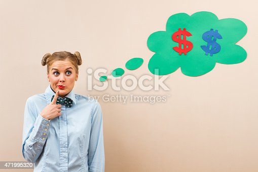 481974106istockphoto A woman thinking about dollars 471995320