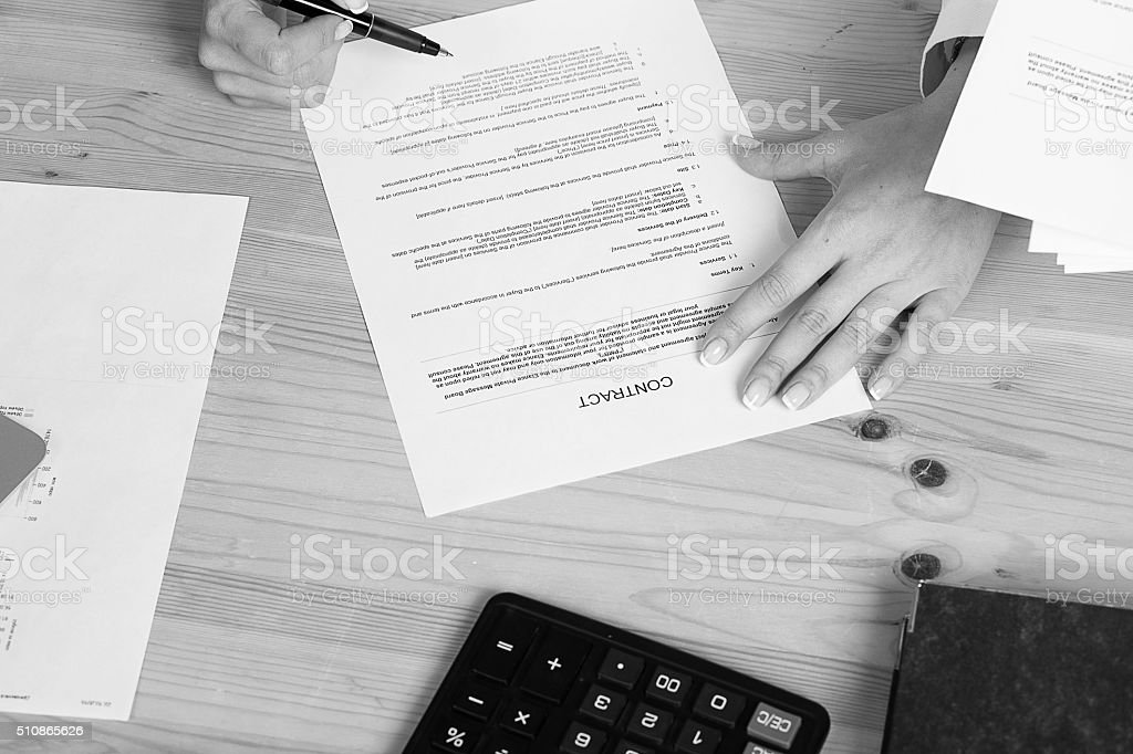 woman thinking about signing a contract stock photo