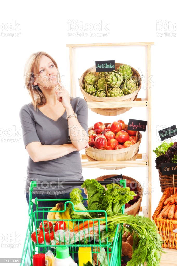 Woman Thinking and Contemplating in Grocery Store on White Background stock photo