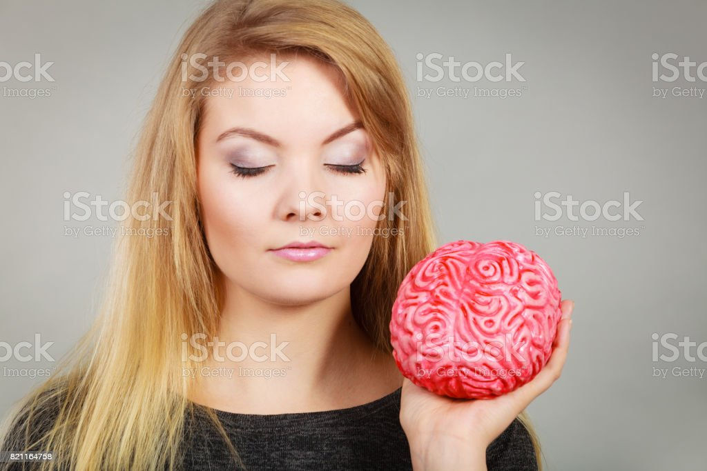 Woman Thinking And Holding Fake Brain Stock Photo - Download