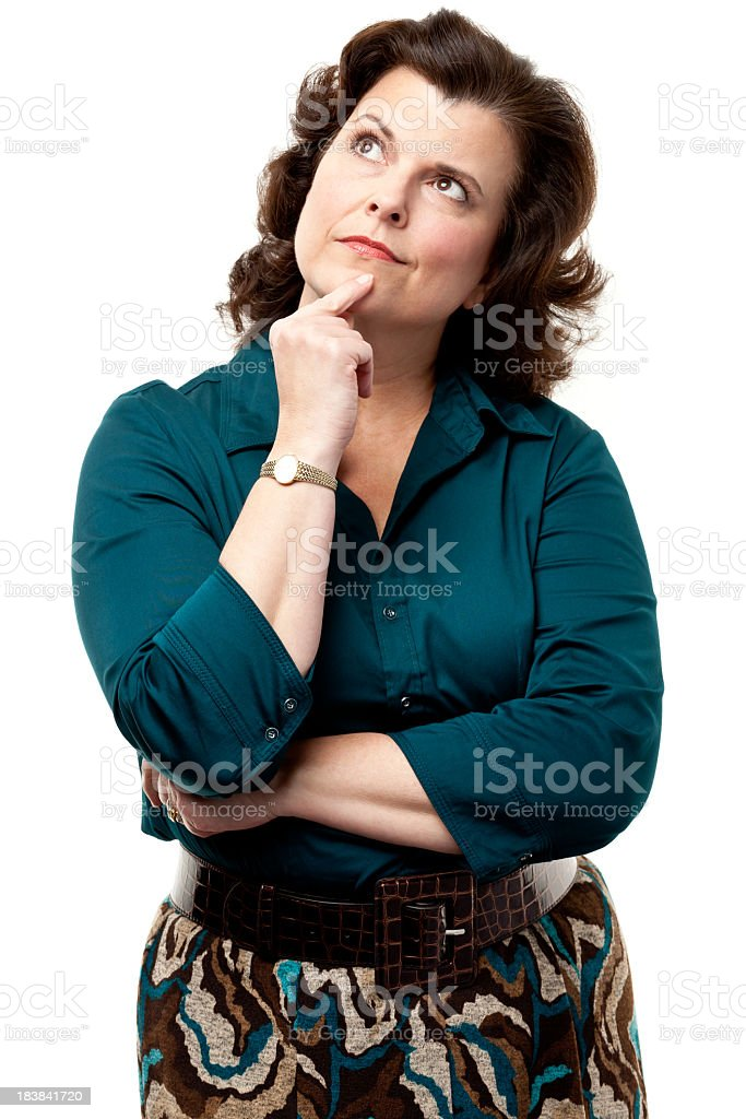 Woman thinking and looking up with finger on chin royalty-free stock photo