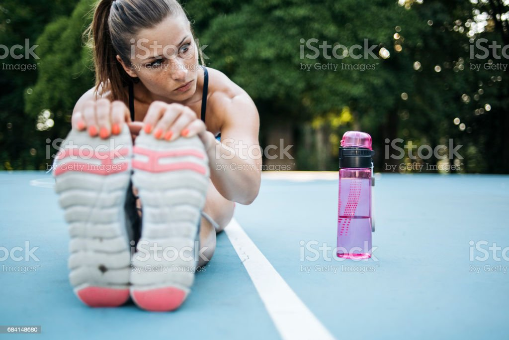 Woman thinking and stretching royalty-free stock photo
