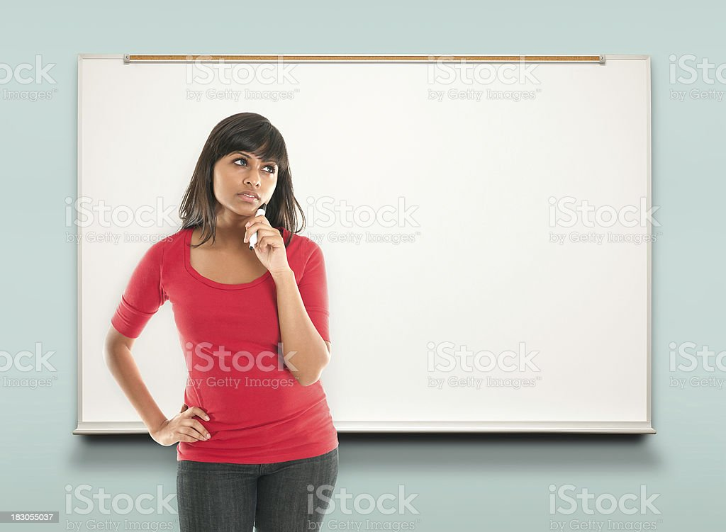 woman thinking at whiteboard royalty-free stock photo