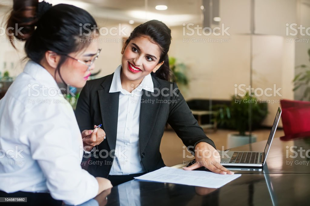 Woman thinking before signing an agreement stock photo