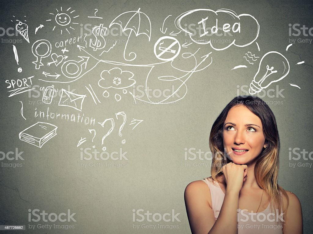 woman thinking dreaming has many ideas looking up stock photo