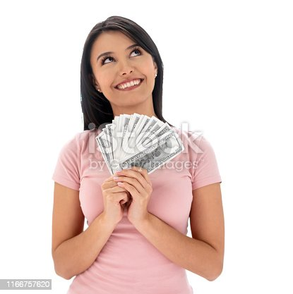Portrait of a happy woman thinking how to spend the money and holding cash while smiling - isolated over a white background