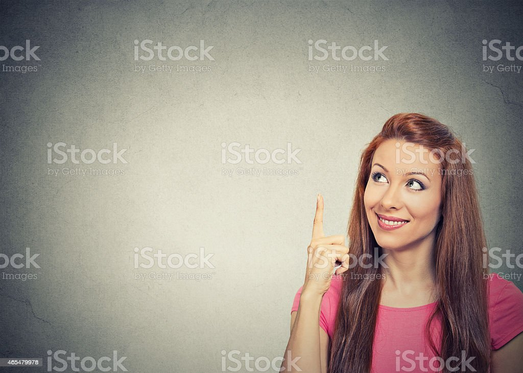 woman thinking looking pointing finger up stock photo
