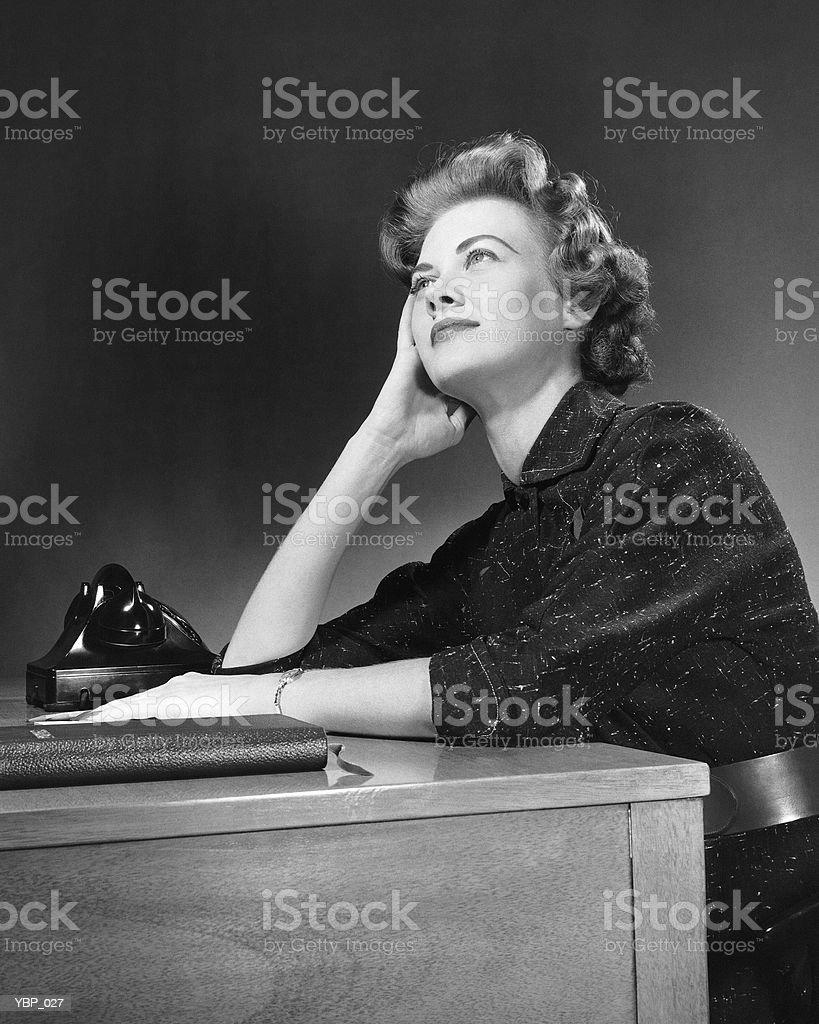 Woman thinking, looking upward royalty-free stock photo