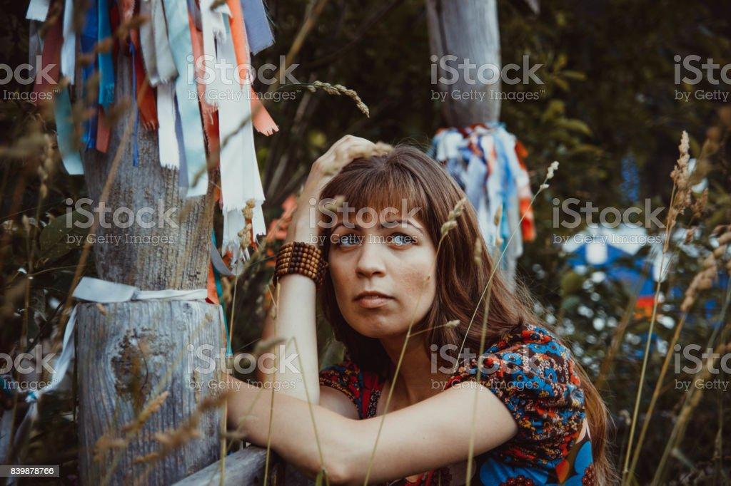 Woman thinking of a tree stock photo