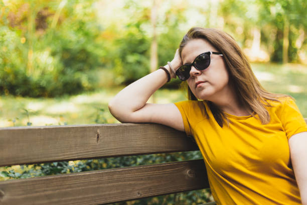 Woman thinking or daydreaming outside stock photo