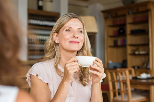 Woman thinking over coffee stock photo