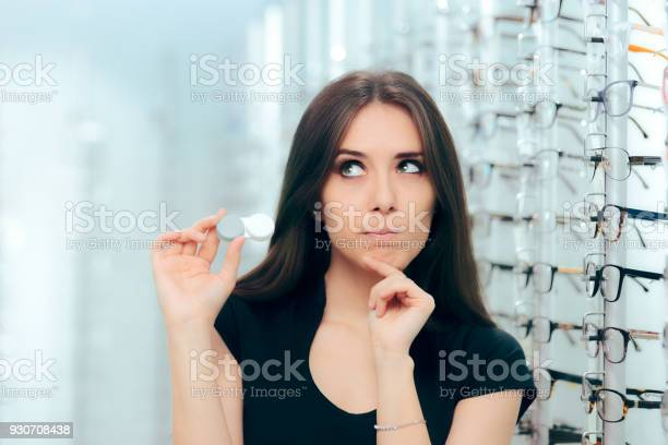 Woman thinking to choose contact lenses over eyeglasses picture id930708438?b=1&k=6&m=930708438&s=612x612&h=ghw3vcqrj3mkmw9pc jjsmojyfvthkox6pncop y1h4=