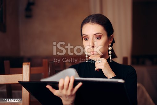 Female client choosing what to eat in a diner