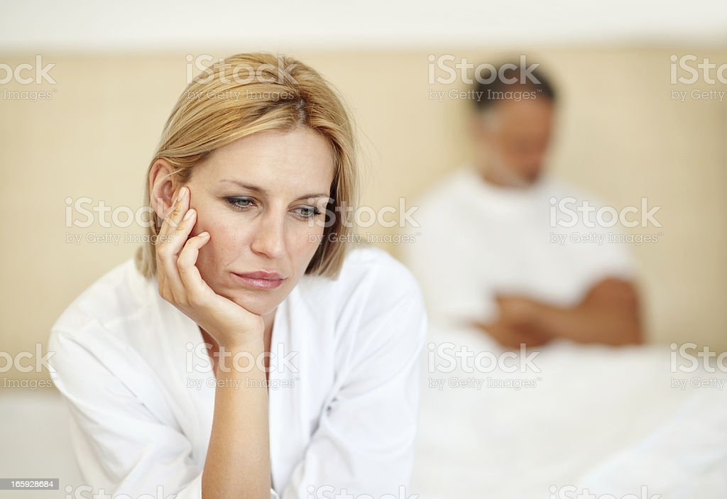Woman thinking with man in the background royalty-free stock photo