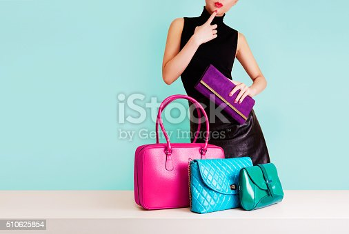 istock Woman thinking with many colorful bags. Shopping. Fashion image. 510625854